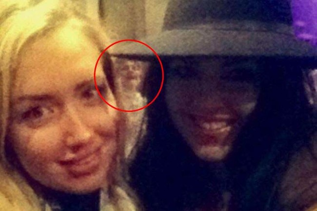 They were just trying to take a selfie on their night out, but this ghost had other plans.